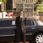 A Photo of Our Chauffeur and A Modern Stretch Limo Rental Indianapolis